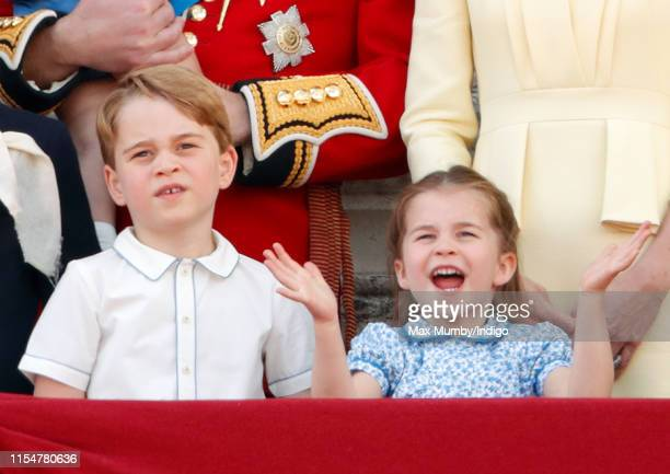 Prince George of Cambridge and Princess Charlotte of Cambridge watch a flypast from the balcony of Buckingham Palace during Trooping The Colour the...