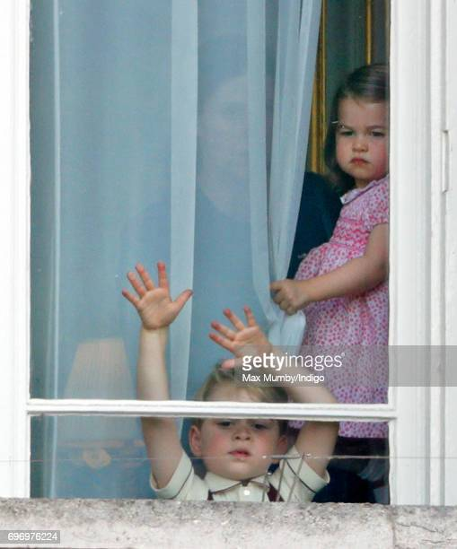 Prince George of Cambridge and Princess Charlotte of Cambridge watch from a window of Buckingham Palace during the annual Trooping the Colour Parade...