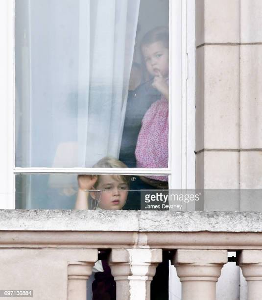 Prince George of Cambridge and Princess Charlotte of Cambridge watch the Trooping the Colour parade from Buckingham Palace on June 17 2017 in London...