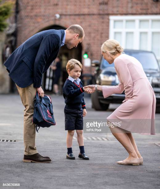 Prince George of Cambridge arrives for his first day of school with his father Prince William Duke of Cambridge as they are met Head of the lower...