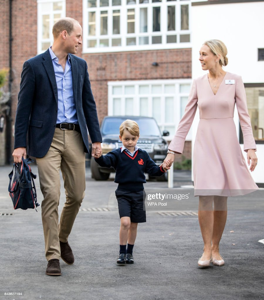 Prince George of Cambridge arrives for his first day of school with his father Prince William, Duke of Cambridge as they are met Head of the lower school Helen Haslem at Thomas's Battersea on September 7, 2017 in London, England.