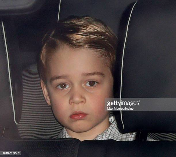 Prince George of Cambridge attends a Christmas lunch for members of the Royal Family hosted by Queen Elizabeth II at Buckingham Palace on December 19...