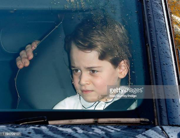 Prince George of Cambridge attends a Christmas lunch for members of the Royal Family hosted by Queen Elizabeth II at Buckingham Palace on December...