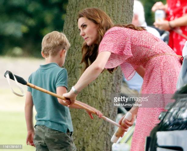 Prince George of Cambridge Catherine and Duchess of Cambridge attend the King Power Royal Charity Polo Match in which Prince William Duke of...