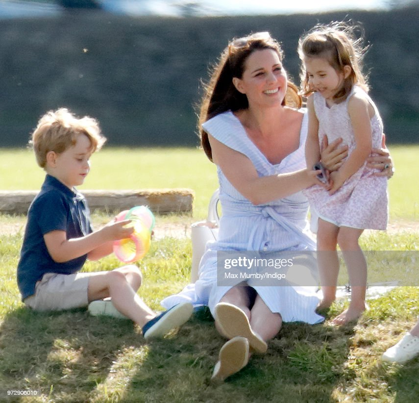 Prince George of Cambridge, Catherine, Duchess of Cambridge and Princess Charlotte of Cambridge attend the Maserati Royal Charity Polo Trophy at the Beaufort Polo Club on June 10, 2018 in Gloucester, England.