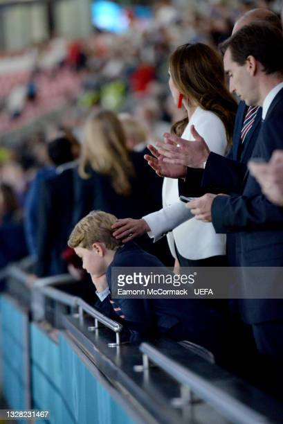 Prince George of Cambridge, Catherine, Duchess of Cambridge, and Prince William, Duke of Cambridge and President of the Football Association are seen...