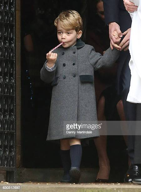 Prince George of Cambridge enjoys a candy cane after attending Church on Christmas Day on December 25 2016 in St Marks' Church in Englefield Berkshire
