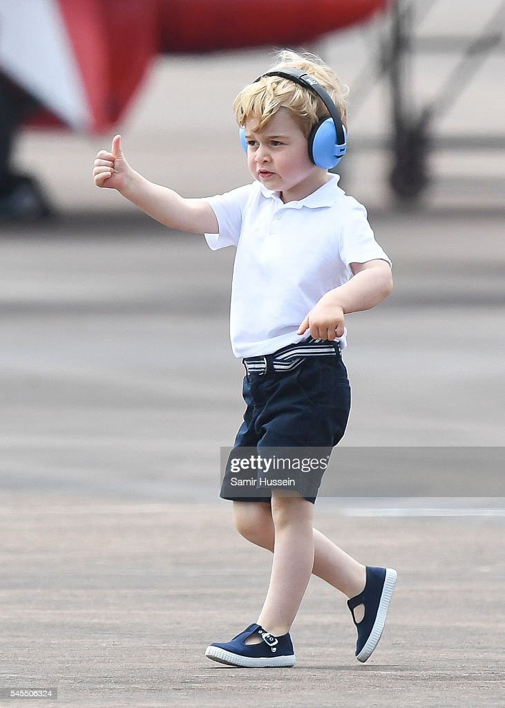Prince George of Cambridge gives a thumbs up as he attends the The Royal International Air Tattoo at RAF Fairford on July 8, 2016 in Fairford, England.