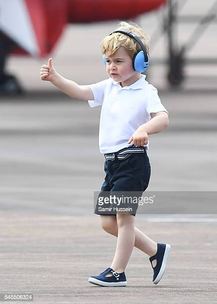 Prince George of Cambridge gives a thumbs up as he attends the The Royal International Air Tattoo at RAF Fairford on July 8 2016 in Fairford England
