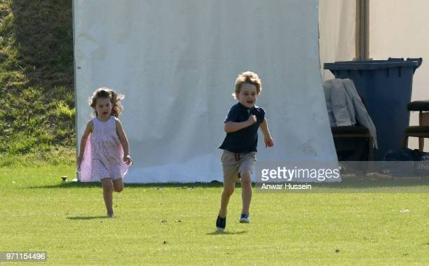 Prince George of Cambridge is chased by Princess Charlotte of Cambridge during the Maserati Royal Charity Polo on June 10 2018 in Gloucester England