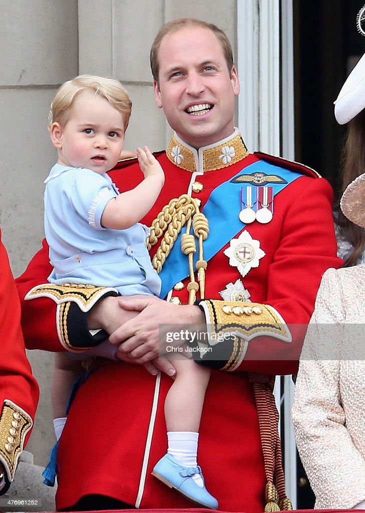 Prince George of Cambridge is held by Prince William, Duke of Cambridge as they look out from the balcony of Buckingham Palace during the Trooping the Colour on June 13, 2015 in London, England. The ceremony is Queen Elizabeth II's annual birthday parade and dates back to the time of Charles II in the 17th Century when the Colours of a regiment were used as a rallying point in battle.