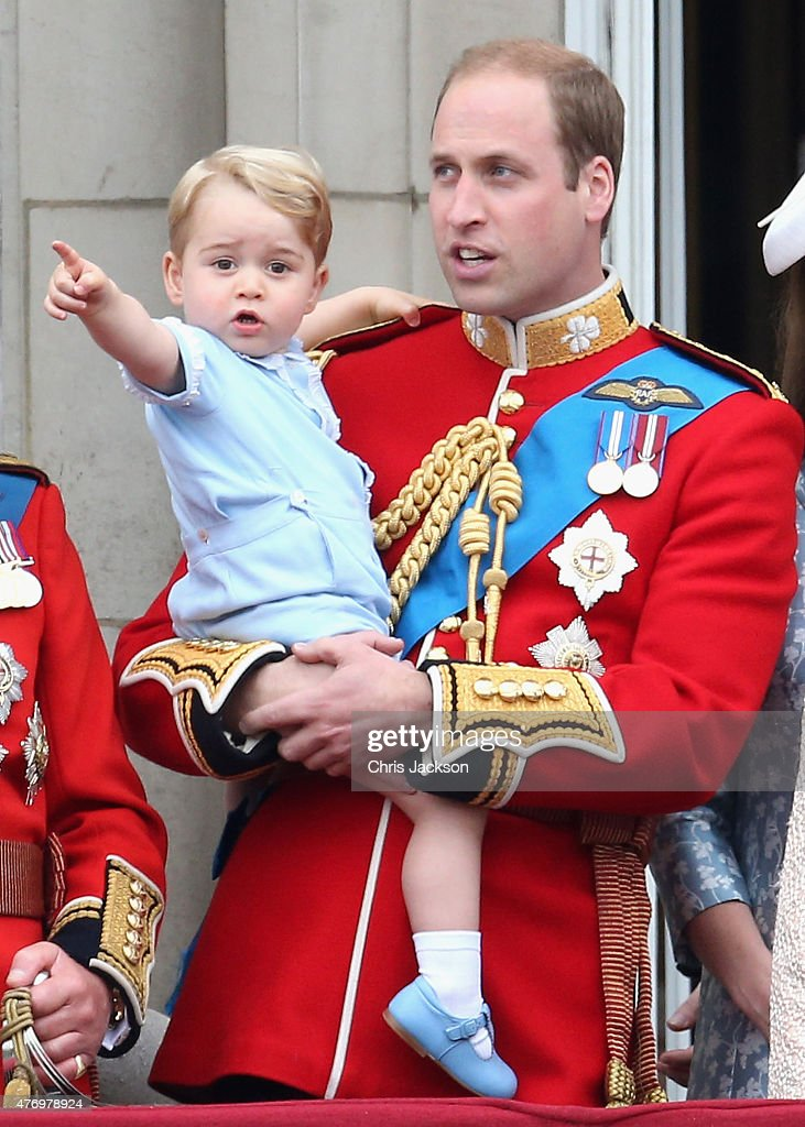 Prince George of Cambridge is held by Prince William, Duke of Cambridge as they look out from the balcony of Buckingham Palace during the Trooping the Colour on June 13, 2015 in London, England. . The ceremony is Queen Elizabeth II's annual birthday parade and dates back to the time of Charles II in the 17th Century when the Colours of a regiment were used as a rallying point in battle.