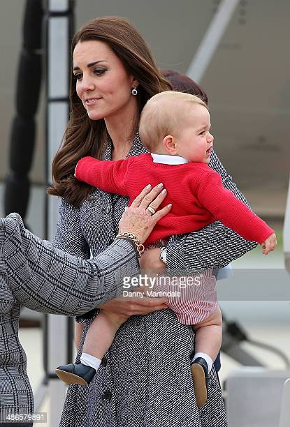 Prince George of Cambridge is seen screaming in Catherine Duchess of Cambridge arms as they depart from Fairbairn Defence Base on April 25 2014 in...