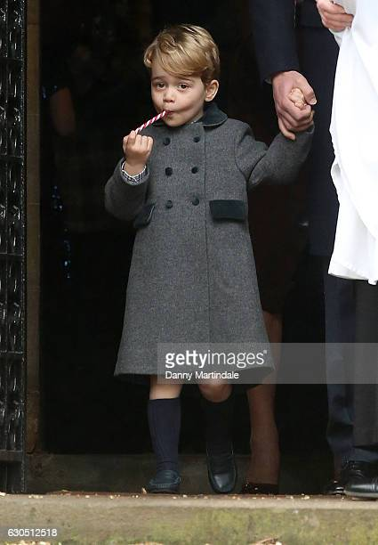 Prince George of Cambridge licks a candy cane at Church on Christmas Day on December 25 2016 in Bucklebury Berkshire