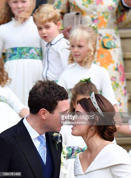 Prince George of Cambridge looks on as Jack Brooksbank and Princess Eugenie kiss following their wedding ceremony at St George's Chapel on October...