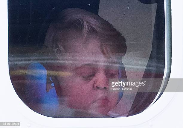 Prince George of Cambridge looks out of the window of a sea plane as he departs Victoria on October 1, 2016 in Victoria, Canada.