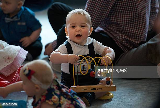 Prince George of Cambridge plays during a Plunket nurse and parents group visit at Government House on April 9, 2014 in Wellington, New Zealand....