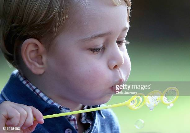 Prince George of Cambridge plays with bubbles at a children's party for Military families during the Royal Tour of Canada on September 29, 2016 in...