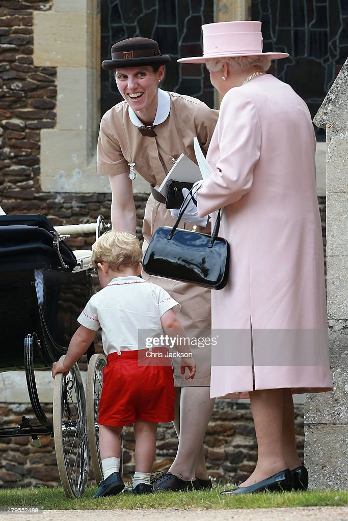 Prince George of Cambridge plays with the wheels of Princess Charlotte's pram as Queen Elizabeth II and Prince George's nanny, Maria Teresa Turrion Borrallo (in her Norland Nanny Uniform) looks on as they leave the Church of St Mary Magdalene on the Sandringham Estate for the Christening of Princess Charlotte of Cambridge on July 5, 2015 in King's Lynn, England.