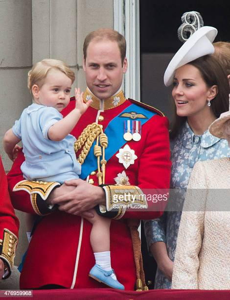 Prince George of Cambridge Prince William Duke of Cambridge Catherine Duchess of Cambridge look on from the balcony during the annual Trooping The...
