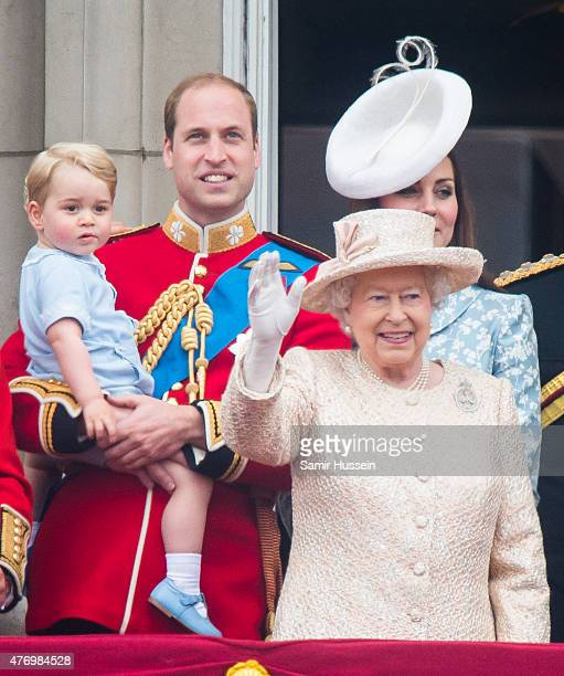 Prince George of Cambridge Prince William Duke of Cambridge Catherine Duchess of Cambridge and Queen Elizabeth II look on from the balcony during the...