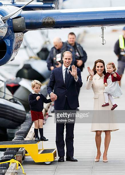 Prince George of Cambridge Prince William Duke of Cambridge Catherine Duchess of Cambridge and Princess Charlotte wave as they leave from Victoria...