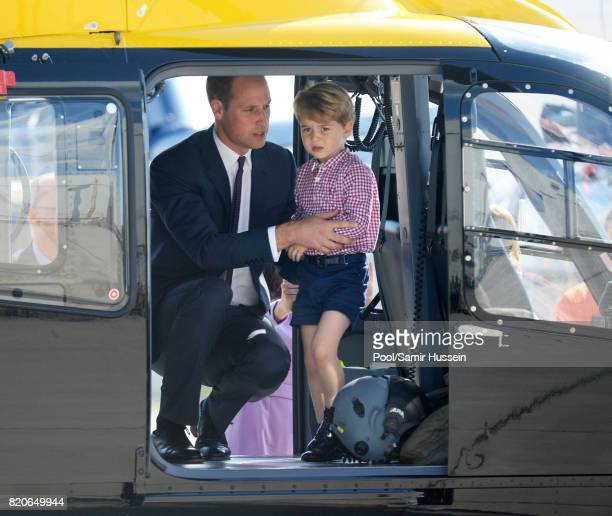 Prince George of Cambridge Prince William Duke of Cambridge look in a helicopter as they depart from Hamburg airport on the last day of their...