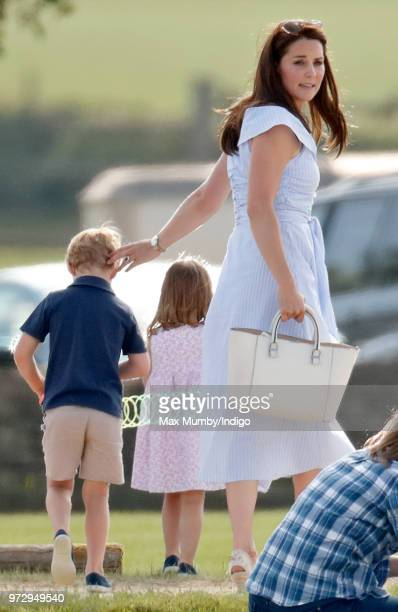 Prince George of Cambridge Princess Charlotte of Cambridge and Catherine Duchess of Cambridge attend the Maserati Royal Charity Polo Trophy at the...