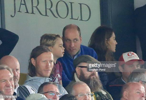 Prince George of Cambridge speaks to Prince William Duke of Cambridge during the Premier League match between Norwich City and Aston Villa at Carrow...