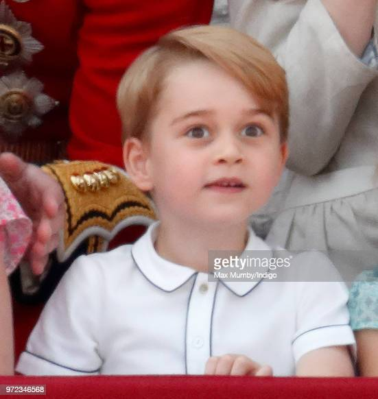 Prince George of Cambridge stands on the balcony of Buckingham Palace during Trooping The Colour 2018 on June 9 2018 in London England The annual...