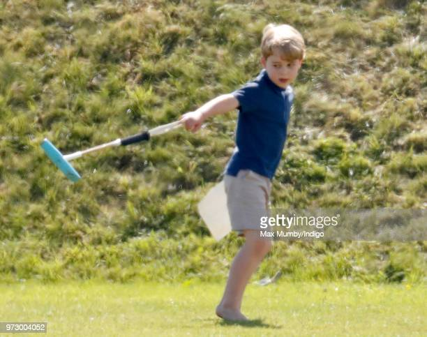 Prince George of Cambridge swings a polo mallet as he attends the Maserati Royal Charity Polo Trophy at the Beaufort Polo Club on June 10 2018 in...