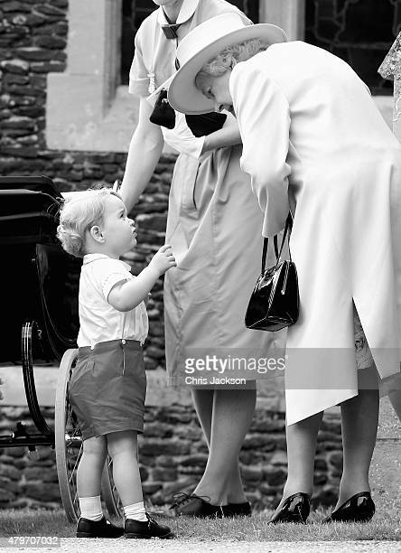 Prince George of Cambridge talks to Queen Elizabeth II as they leave the Church of St Mary Magdalene on the Sandringham Estate for the Christening of...