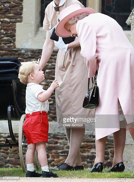 Prince George of Cambridge talks to Queen Elizabeth II outside the Church of St Mary Magdalene on the Sandringham Estate for the Christening of...