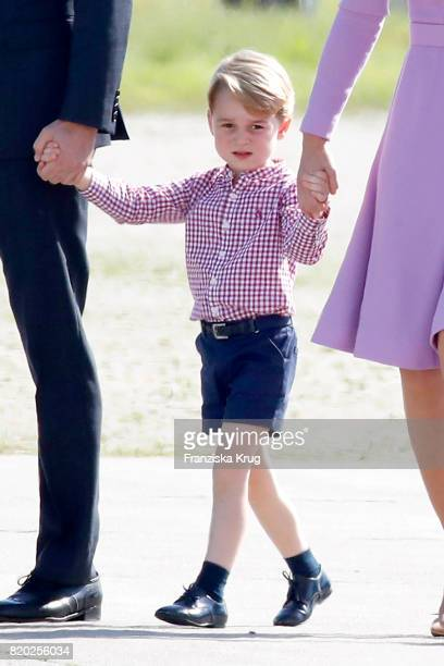Prince George of Cambridge views helicopter models H145 and H135 before departing from Hamburg airport on the last day of their official visit to...