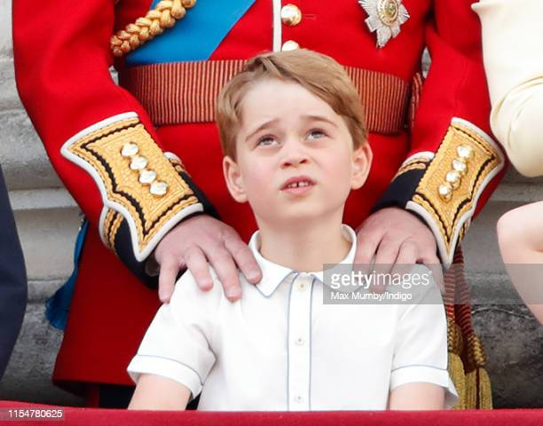 Prince George of Cambridge watches a flypast from the balcony of Buckingham Palace during Trooping The Colour, the Queen's annual birthday parade, on...