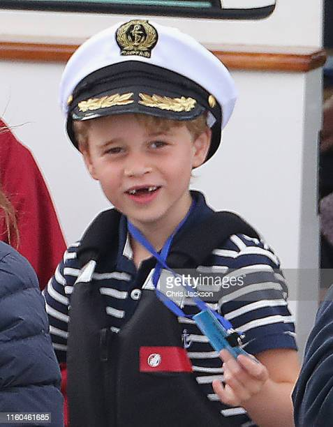 Prince George of Cambridge watches Catherine Duchess of Cambridge at the helm competing on behalf of The Royal Foundation in the inaugural King's Cup...