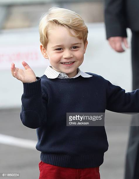 Prince George of Cambridge waves as he leaves from Victoria Harbour to board a sea-plane on the final day of their Royal Tour of Canada on October 1,...