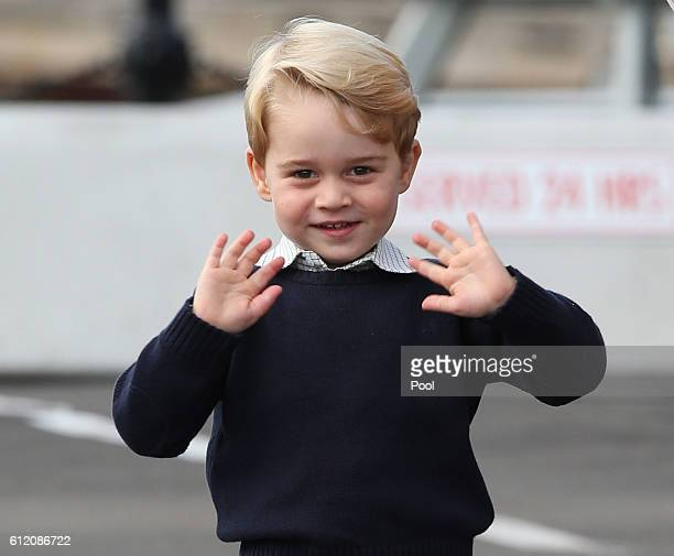 Prince George of Cambridge waves as he leaves from Victoria Harbour to board a seaplane on the final day of their Royal Tour of Canada on October 1...