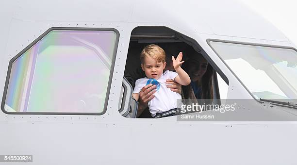 Prince George of Cambridge waves from the cockpit of a plane as he attends the The Royal International Air Tattoo at RAF Fairford on July 8 2016 in...