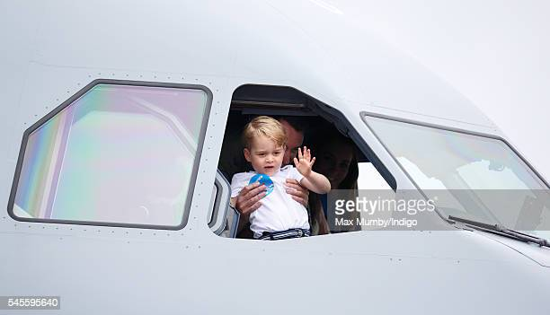 Prince George of Cambridge waves from the cockpit of an Australian Air Force plane as he visits the Royal International Air Tattoo at RAF Fairford on...
