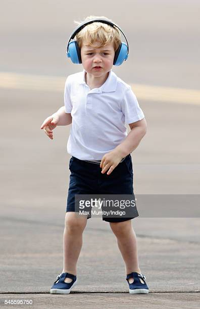 Prince George of Cambridge wears ear defenders as he visits the Royal International Air Tattoo at RAF Fairford on July 8 2016 in Fairford England
