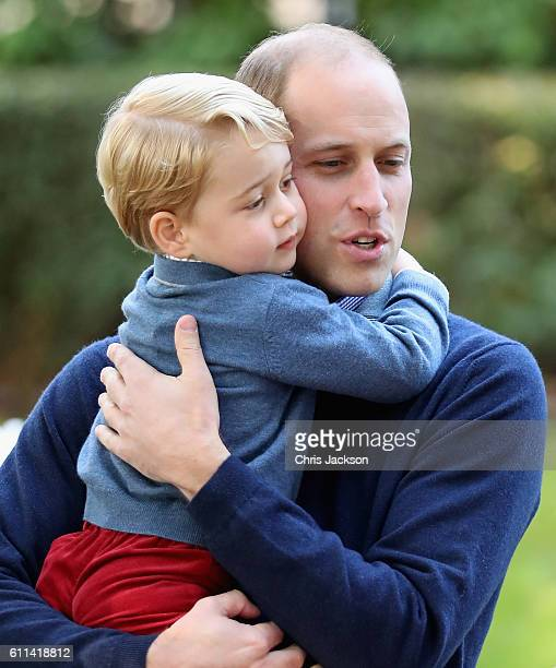 Prince George of Cambridge with Prince William, Duke of Cambridge at a children's party for Military families during the Royal Tour of Canada on...