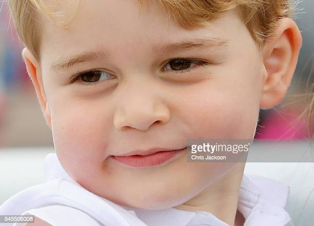 Prince George waves during a visit to the Royal International Air Tattoo at RAF Fairford on July 8, 2016 in Fairford, England.