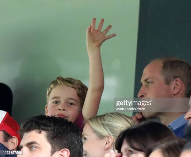 Prince George waving at Carrow Road as he watches with his father Prince William during the Premier League match between Norwich City and Aston Villa...