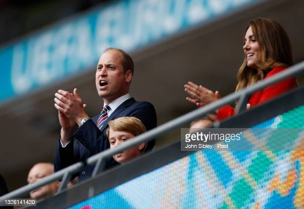 Prince George with his parents Prince William, President of the Football Association and Catherine, Duchess of Cambridge applaud after the UEFA Euro...