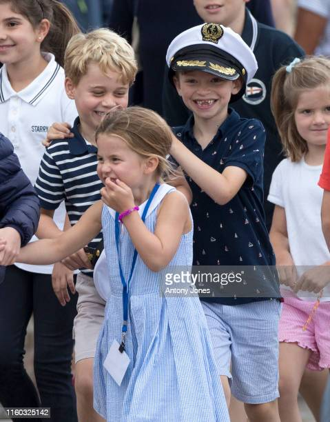 Prince George with Princess Charlotte at The Royal Yacht Squadron during the inaugural Kings Cup regatta hosted by the Duke and Duchess of Cambridge...