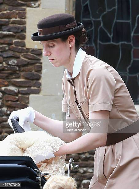 Prince George's nanny Maria Teresa Turrion Borrallo helps secure Princess Charlotte of Cambridge in her pram as she leaves the Church of St Mary...
