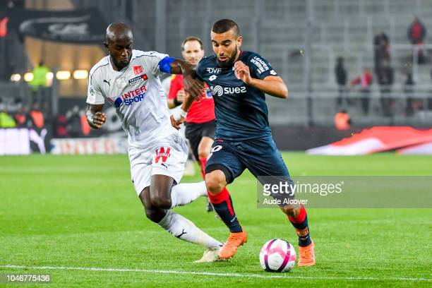 Prince Gouano of Amiens and Naim Sliti of Dijon during the Ligue 1 match between Amiens and Dijon at Stade de la Licorne on October 6 2018 in Amiens...