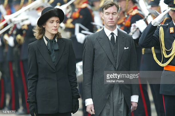 Prince Guillaume and Princess Sibilla of Luxembourg bow to the Dutch Royal standard after the funeral of Prince Claus of the Netherlands at the...