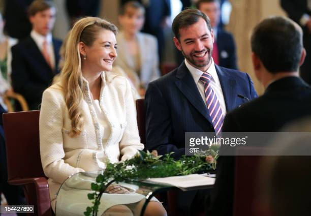 Prince Guillaume, heir to the thrown of Luxembourg, and Belgium's Countess Stephanie de Lannoy smile during their civil wedding, on October 19, 2012...